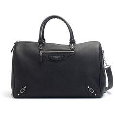 Rosie Huntington-Whiteley wearing Balenciaga Voyage 24h in Noir Bag.