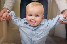 Funny smile on a 1-year old boy. Lifestyle portrait by N. Lalor Photography.