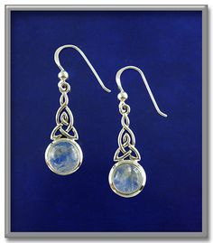 "Celtic Moonstone Earrings - Rainbow moonstone cabochons set in sterling silver knotwork reflect the radiance of the full moon. For pierced ears only, on French hooks. Earrings measure 1-1/2"" tall.<BR><BR><span class=""clearance"">New Lower Price!</span>"