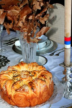 A česnica is the ceremonial, round loaf of bread that is an indispensable part of Christmas dinner in Serbian tradition. A coin or other small object is put into the dough during the kneading. At the beginning of Christmas dinner, the česnica is rotated three times counterclockwise, then broken among the family members. The person who finds the coin in his piece of the bread is to be exceptionally lucky in the coming year. The česnica was used in folk magic for divining or influencing crops.