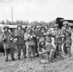 Members of 12th Parachute Battalion enjoy a cup of tea after fighting their way back to Allied lines after three days behind enemy lines.Normandy, june 10, 1944