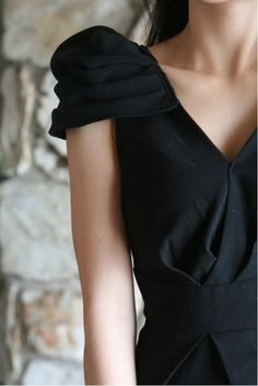 Good idea: adding a pleated puffy sleeve to a sleeveless dress.