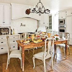 A rustic farm table takes the place of a central island in the kitchen, creating a spot for casual meals.