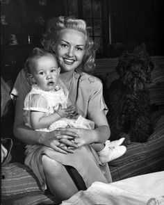 Betty Grable and daughter, (she had two daughters, Victoria & Jessica) not sure which daughter is with her in this picture.