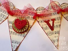 Love Garland, using old sheet music and other craft supplies