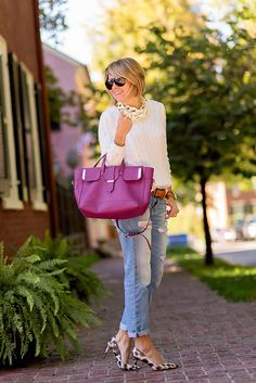 Boyfriend jeans paired with a crewneck sweater is one of our go-to looks this fall. Blogger Seersucker + Saddles adds a pop of color to her Gap jeans with her statement bag and heels.