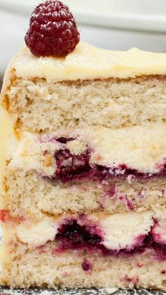 Frostbitten Raspberry Cake ~ Delicate vanilla cake layers filled with mascarpone cream and raspberry compote and covered with white chocolate buttercream.