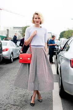 Shop this look for $145:  http://lookastic.com/women/looks/light-blue-cropped-sweater-and-white-and-black-full-skirt-and-black-heels-and-red-satchel-bag/2400  — Light Blue Cropped Sweater  — White and Black Geometric Full Skirt  — Black Leather Pumps  — Red Leather Satchel Bag