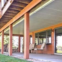 Convert the space under a second-story deck into a dry, spacious patio by installing this simple, under-the-deck roof and gutter system #outdoor #deck #ideas.
