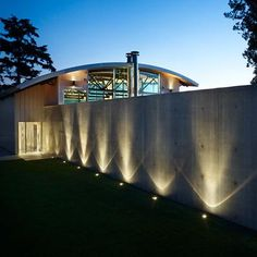 Uplighting the concrete wall for dramatic effect.