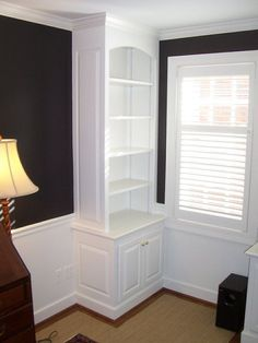 Custom made built-in book shelf and storage to match existing units