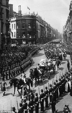 U.K. Queen Victoria in her carriage leads a procession driving through London during her Diamond Jubilee celebrations in June 1897.