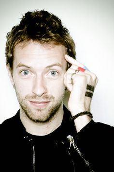 Chris Martin. I live how he always has the MTF sign on his hand!