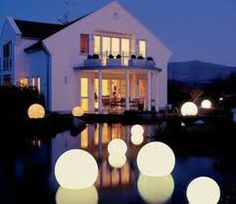 light orbs floating in a pool.