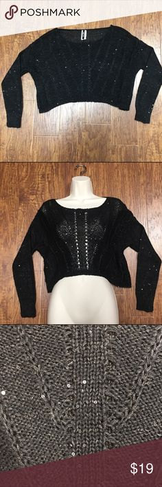 "Adorable black cropped sweater shrug Absolutely adorable black cropped sweater. Medium knit crop sweater with long sleeves and tiny sequins for just a touch of sparkle. Looks amazing with just about anything. Wear a plain black top underneath or give it some more sparkle by adding something sparkly underneath such as a bandeau or sequin tank top. Size small/medium. 🚫MEASUREMENTS LAYING FLAT:   Armpit to armpit:  24"" Waist:  20.5"" Length from shoulder to bottom:  16"" Sleeve: west 36th Tops…"