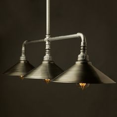 Large Galvanised Plumbing Pipe Table Pendant. This light fitting can be used to light up a table or bar or just as a ceiling light feature.