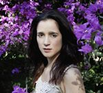 August 2013 featured music: Julieta Venegas (born November 1970) is a Mexican singer, instrumentalist, and songwriter who performs Spanish-language rock and pop music.