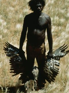 An Aborigine Displays a Wild Turkey He Shot in the Great Sandy Desert Near Yagga Yagga. Sam Abell