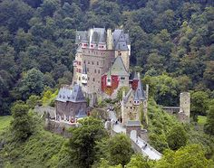 Burg Eltz is a medieval castle nestled in the hills above the Moselle River, between Koblenz and Trier, Germany. It is still owned by a branch of the same family that lived there in the 12th century, 33 generations ago..  Also happens to be Rick Steves's favorite castle in all of Europe (as if I needed any more reasons to want to visit a castle).