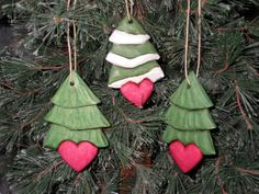 Pine trees with a heart. This set of three hand carved tree ornaments is approx. 4 long, 1/2 thick and each tree has a fine hemp cord through the top for hanging on a hook, hanger or Christmas tree. One tree has snow on its branches while the other two are snow-free. My initials are written on the bottom of each one. These can do double duty for either Valentines Day or Christmas and can be displayed all year round. Perfect for nature lovers. I ship the same or next business day. The tr...
