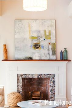 like the stones in the inside of the fireplace  with wood mantel and surround