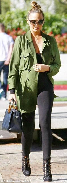Helping them pick out some items: Kim and Kanye were shopping with pals Chrissy Teigen and John Legend