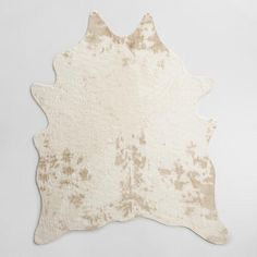 """Our animal-friendly faux cowhide rug captures the chic, authentic look and remarkable texture of natural cowhide. This easy-care, """"vegan"""" hide has a sumptuously soft underfoot feel."""