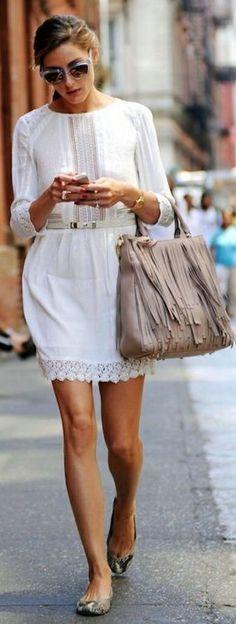 White lace dress & beige fringe bag.