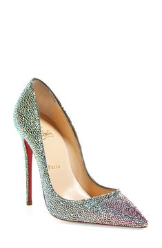 Swoon worthy Christian Louboutin pumps adorn with glittering Swarovski crystals.