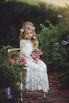 Pretty long-sleeve lace flower girl dress | Junebug Weddings