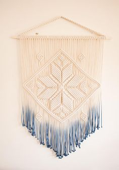 This blue ombre macrame wall hanging was inspired by the ancient symbol of the eight pointed star that stands for Mothers love. This symbol was widely used by the slavic people that lived all over eastern and central Europe hundreds of years ago. It could be find on the old times