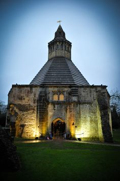 There is an air of a haunting castle when night falls on the Abbot's kitchen. Come and venture into this atypical building! Plan your visit online www.glastonburyabbey.com. Glastonbury Abbey, Atypical, Somerset, Castle, Mansions, Night, Architecture, House Styles, Building