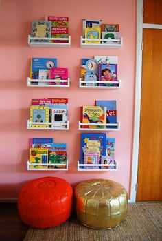 Ikea Spice Racks Turned Bookshelves in the kids room to help organize books. Paint color schemes