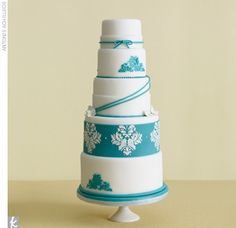 Seven-tiered white fondant wedding cake stacked and accented with aqua bands and a damask applique pattern. Teal Cake, Blue Cakes, Damask Cake, Turquoise Cake, Pretty Cakes, Beautiful Cakes, Damask Wedding, Magenta Wedding, Wedding Fun