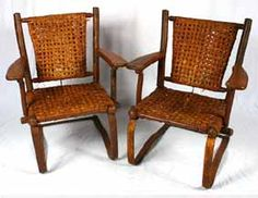 "Old Hickory Furniture Martinsville set of 2 porch bouncy chairs on cantilever metal bases.  Brand mark.  35 1/2""H x 27\""W x 19\""D.  Some wear to caning.  Wear and loss to original enamel on metal.  Sold as is."
