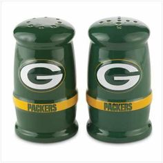 """Green Bay Packers Shakers - Style 37346 by Gift Warehouse. $10.99. Made of ceramic. A gift for your favorite fan. Each shaker is 2"""" diameter x 3 1/2"""" high. Team spirit comes to the dinner table to spice up every meal! These one-of-a-kind salt and pepper shakers are a winning way to display your dedication; or as a gift for your favorite fan, they're sure to score a touchdown! Ceramic. Each shaker is 2"""" diameter x 3 1/2"""" high.. Save 26%!"""