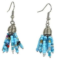Blue Maasai Beaded Spike Earrings Handmade and Fair Trade. Handmade in Kenya, these earrings feature short strands of colorful glass seed beads hung from a silverplated coil cap. The earrings hang 1.5 inches from hypoallergenic hooks.