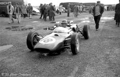 Jim Clark 1961 Jim Clark on his way out of the paddock to practice for the 1961 British Grand Prix at Aintree, Liverpool in his Lotus 21 Climax entered by Team Lotus.He qualified 8th. on the starting grid but he had to retire on lap 62 due to an oil leak.He was Formula 1 World Champion in 1963 and 1965