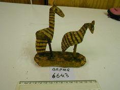 Carved wooden giraffes  BRPMG 6643.