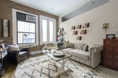 A gold antique mirror and exposed brick walls elevate this beautiful 1 bedroom.