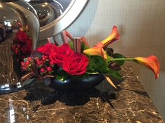 Floral arrangement with roses & lilies