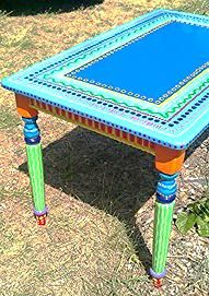 Painted table fun for a picnic table maybe add turtles or peacocks...