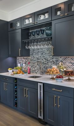 This seven-bottle wine cooler by Vinotemp inspired us to use this kitchen space as a wet bar. Cool Glass Elegance Mosaic Tile by The Tile Shop.