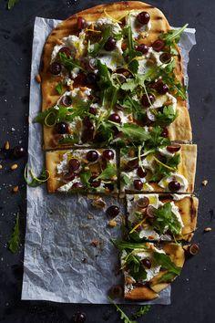 Tiffani Thiessen's Pizza with Ricotta, Arugula and Grapes Recipe 8 oz. refrigerated pizza dough ½ cup ricotta cheese 2 cups arugula ½ cup red grapes, sliced in half 2 tbsp. pine nuts Zest of 1 lemon Arugula Recipes, Grape Recipes, Pizza Recipes, Appetizer Recipes, Dinner Recipes, Appetizers, Cooking Recipes, Healthy Recipes, Party Recipes