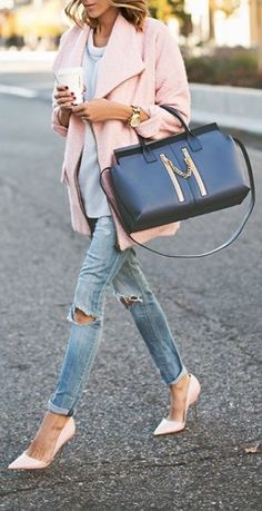 Casual chic in a soft pink coat, distressed skinnies, and a carryall duffle.
