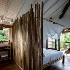 Loving the use of African latte poles to separate the bedroom from ensuite! #bedroominspo #africandecor #safarilodge #zanzibarisland