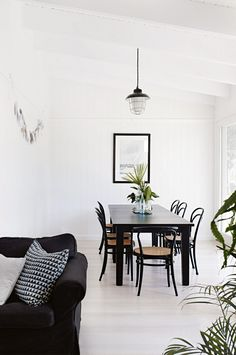 Vintage Beach Home In Black And White: Black white dining rafters