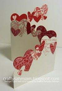All items used were from Stampin' Up! Riding Hood Red card stock and ink Very Vanilla card stock and craft ink several background stamps heart shaped punches