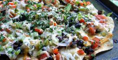 """Veggie Nachos- Heavy on the veggies, lite on the cheese, use lite healthy """"chips"""" (or toasted whole wheat pitas)"""