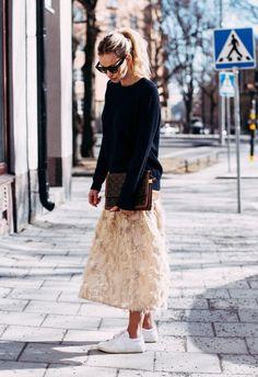 A cashmere sweater over a maxi skirt